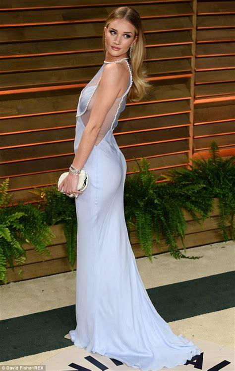 Rosie Huntington Whiteley wows in ice blue dress alongside Jason Statham at Vanity Fair Oscars