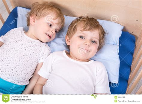 fun in bed two little toddler boys having fun in bed royalty free