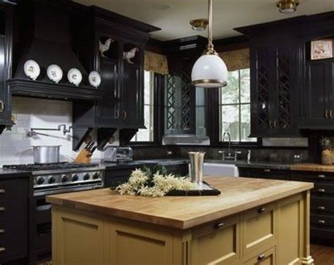 black and brown kitchen cabinets black kitchen cabinets not painting the kitchen island
