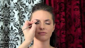 mack no hair lips make up pin up make up with cat eyes and a red lip on