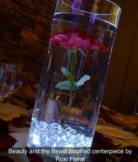 Image result for beauty and the beast wedding centerpieces