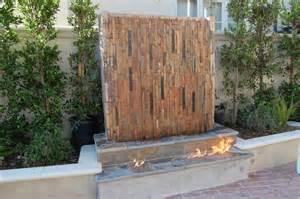 fireplace with waterfall contemporary patio orange