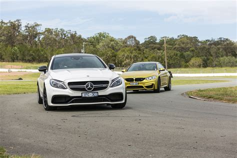 bmw m4 competition v mercedes amg c63 s coupe track