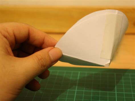 How Do You Make A Cone Out Of Paper - how to make a funnel or cone from paper 3 steps with