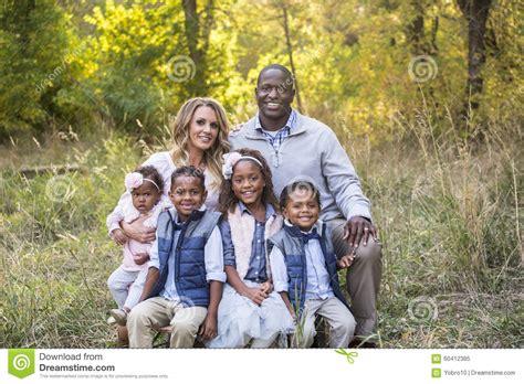 beautiful family beautiful multi ethnic family portrait outdoors stock