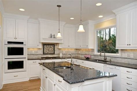 blue pearl granite with white cabinets white speckle countertops with black appliances soft