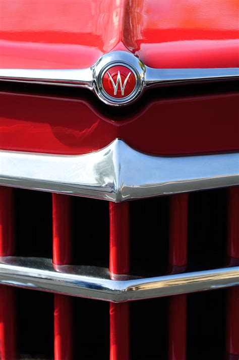 willys overland logo 1950 willys overland jeepster hood emblem photograph by
