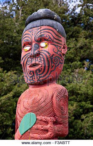 eye tattoo rotorua maori wooden statue sculpture tattoo new zealand stock