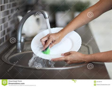 Washing Baby In Kitchen Sink Washing Dishes In The Kitchen Sink Stock Image