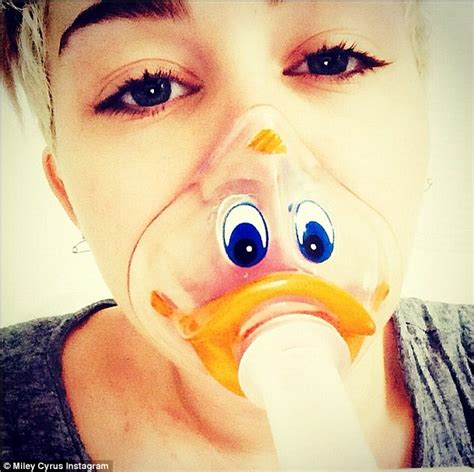 miley cyrus skinny instagram pic fans react to bony miley cyrus cracks jokes in duck face oxygen mask while