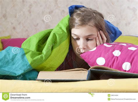 reading in bed girl reading in bed stock images image 29614494