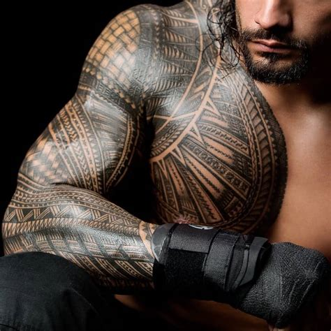 wwe star roman reigns with samoan sleeve tattoo truetattoos
