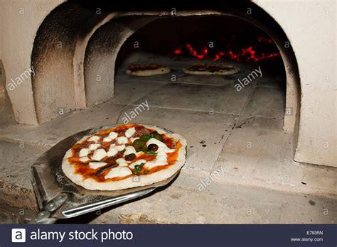 Handmade Oven - pizza with sourdough crust on aluminium pizza