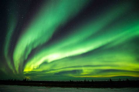 what creates the northern lights how to spot the northern lights columbia