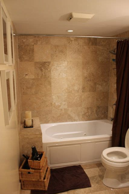 tile tub wall matches floor color scheme browns tans and