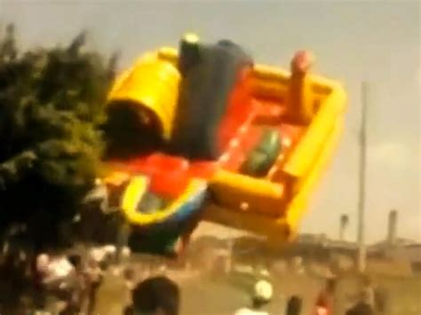 bounce house blows away children s slide blows away in brazil people com