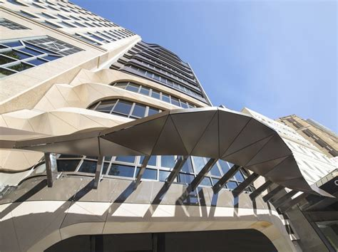 eliza apartments sydney building flats housing e tony owen partners warps facade of eliza apartments in sydney