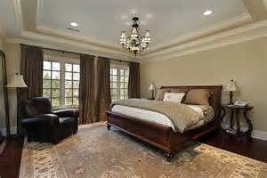 Ideas For Decorating Bedroom decorated master bedroom with large rug timber floor and classic