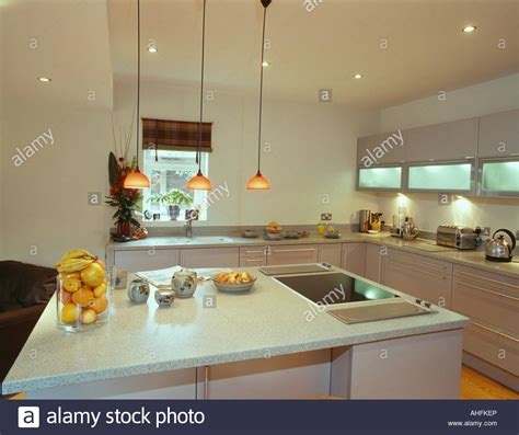 Modern Kitchens With Islands pendant lights over island unit with halogen hob and