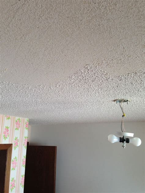 scrape popcorn ceiling how to cover popcorn ceilings a