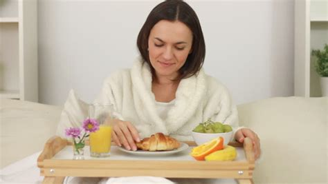 do you tip at a bed and breakfast woman eating breakfast in bed stock footage video 1825136