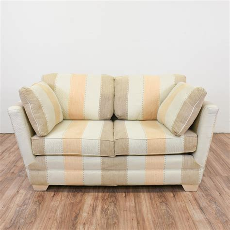 this long striped loveseat sofa is upholstered in durable