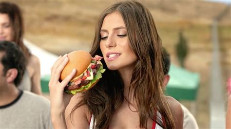 girls in hardees commercials carl s jr says this provocative border ball ad is about