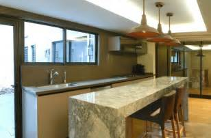 lights above kitchen island renovated mexican residence with a home office and a