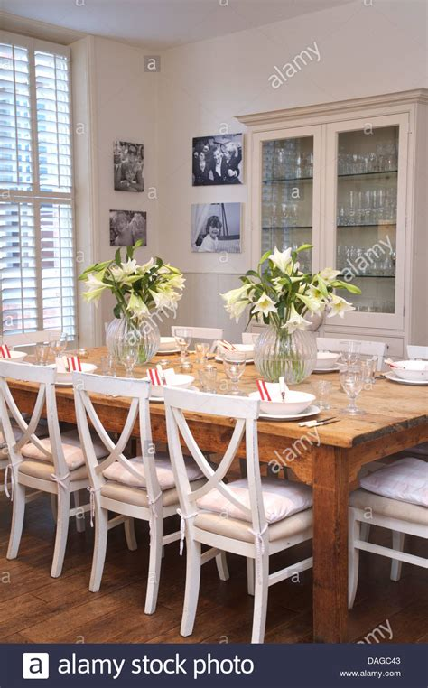 white wood dining room table white painted chairs at plain wood table in country dining