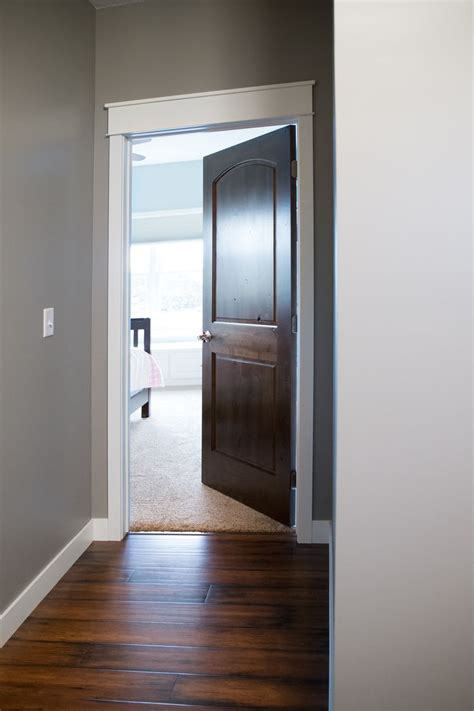 Trim Interior Door Interior Doors White Trim And Door Topper Paired With A Two Panel Arch Top Door Prefinished