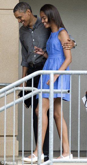 barack obama gets a sneaky visit from daughter sasha in first daughters malia and sasha obama blossom into young