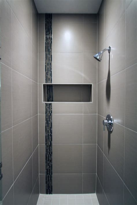 The Porcelain Tile Of This Sleek Shower Surrounds A Glass Bathroom Tile Accessories