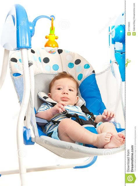 swing for baby boy baby boy in electrical swing stock photography image