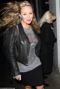 janine butcher curly hair charlie brooks teams biker jacket with grungy grey t shirt