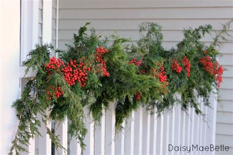images of christmas garland on a fences 1000 images about decorations on fences on fence gates and picket fences
