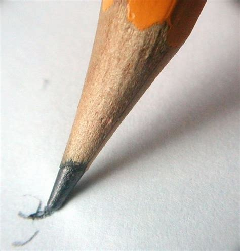 pencil writing on paper pencil free stock photo closeup of a pencil writing on