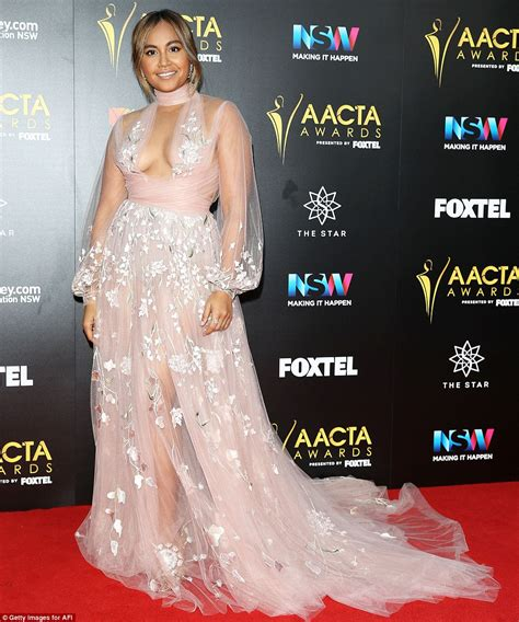 Borat Isla And Purple Dress by Aacta Awards 2016 Isla Fisher Cuddles Up To Husband Sacha