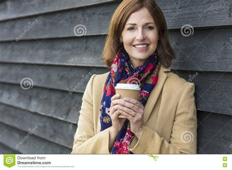 middleage woman fun happy attractive middle aged woman drinking coffee stock
