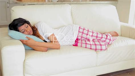 lying on the couch woman lying on the couch sleeping royalty free video and