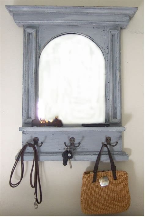 the arch mirror with shelf hooks mudroom entry