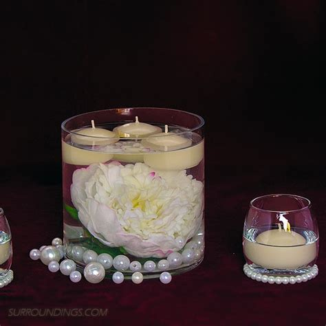 wedding centerpieces with candles and pearls peony pearls in cylinder floating candle centerpiece