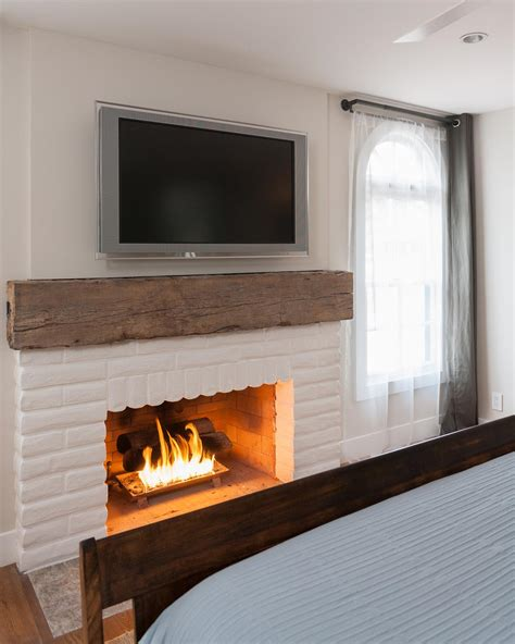Fireplace Mantels On Brick by 15 Gorgeous Painted Brick Fireplaces Hgtv S Decorating