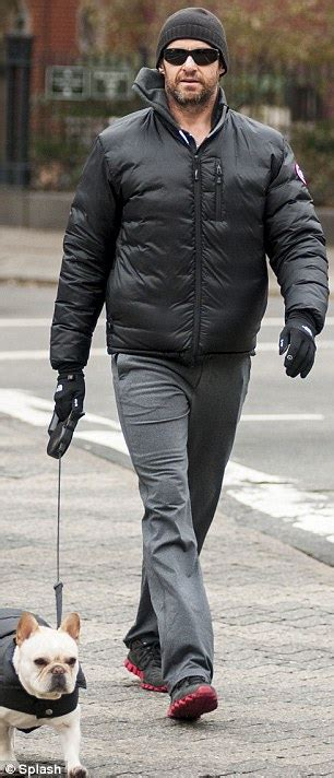 45 yr old mens clothing hugh jackman and family wear matching black puffer coats