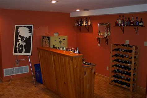 Easy Basement Bar Ideas Cool Orange Accents Wall Paint Of Home Basement Bar Designs Idea Feat Simple Bar Table And