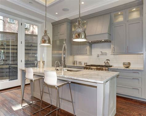 light gray kitchen cabinets with white countertops the psychology of why gray kitchen cabinets are so popular