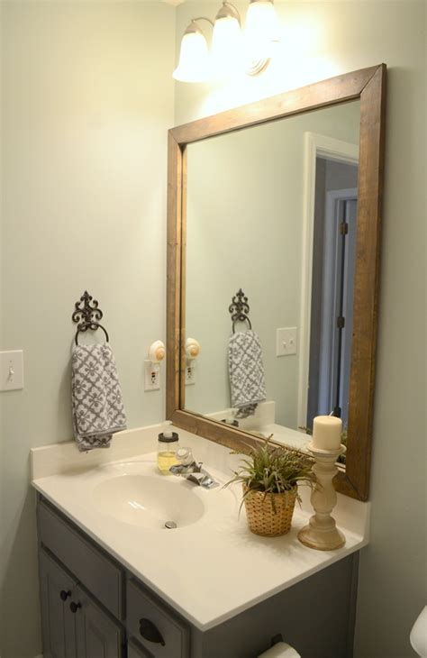 wood framed mirrors for bathrooms guest bathroom update stained wood framed bathroom mirror