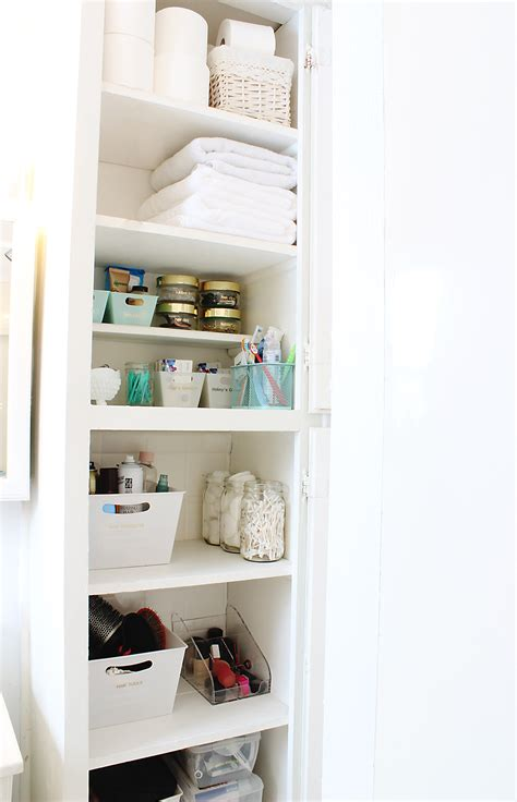 How To Organize Your Bathroom In 3 Easy Steps Classy Clutter Bathroom Closet Storage