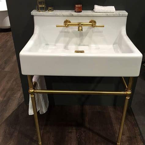 bathroom sink console say yes to brass the dxv by amstandard oak hill console