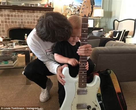louis tomlinson teaches son freddie the electric guitar
