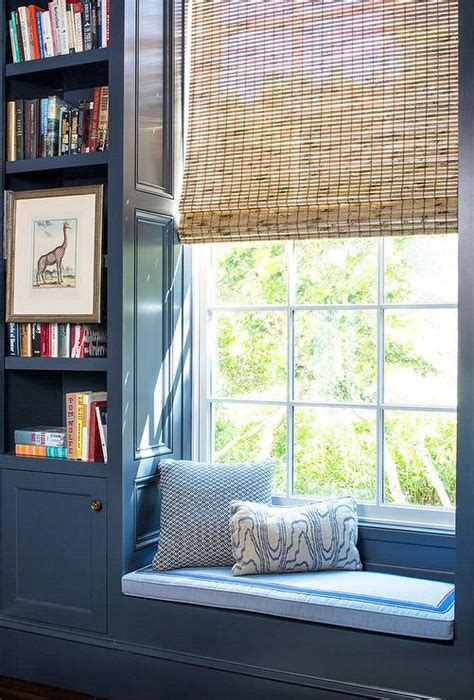window seat flanked by bookcases interior design inspiration photos by andrew howard